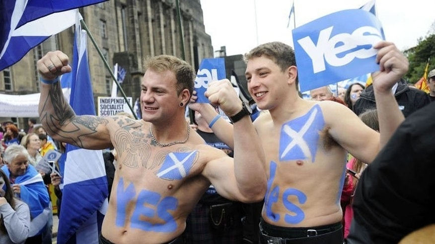 "Pro-independence supporters wearing kilts pose for photographs as people gather for a rally in Edinburgh on September 21, 2013. Voting for Scottish independence is ""common sense"", the leader of the movement to break away from the United Kingdom insisted a year to the day befor Scotland votes in a referendum."