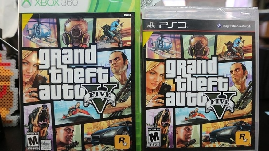 Copies of Grand Theft Auto V displayed at the 8 Bit & Up video game shop in Manhattan's East Village on September 18, 2013 in New York. Three British teenagers have been charged over the stabbing and robbery of a man who was walking home after buying the blockbuster videogame, police said on Saturday.
