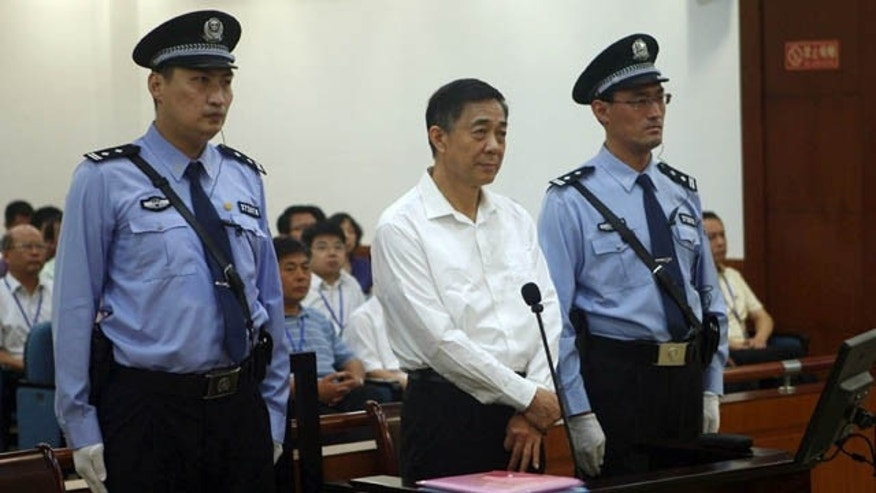 FILE - In this Aug. 22, 2013 file photo released by the Jinan Intermediate People's Court, former Politburo member and Chongqing city party leader Bo Xilai, center, stands on trial at the court in eastern China's Shandong province.  (AP Photo)