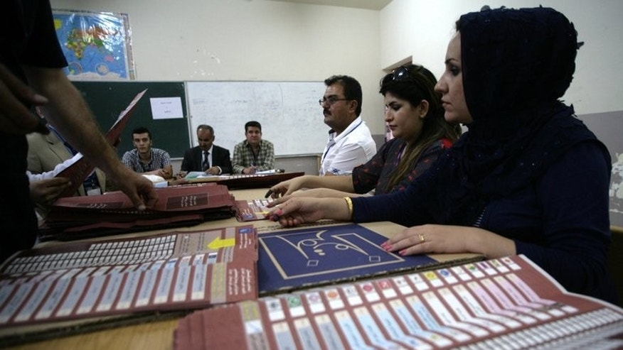 Iraqi Kurdish poll officials count ballots for the Kurdistan's legislative election on September 21, 2013.