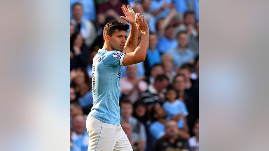 Manchester City's Argentinian striker Sergio Aguero celebrates scoring the opening goal during the English Premier League football match between Manchester City and Manchester United at the Etihad Stadium in Manchester, northwest England, on September 22, 2013. City won 4-1.