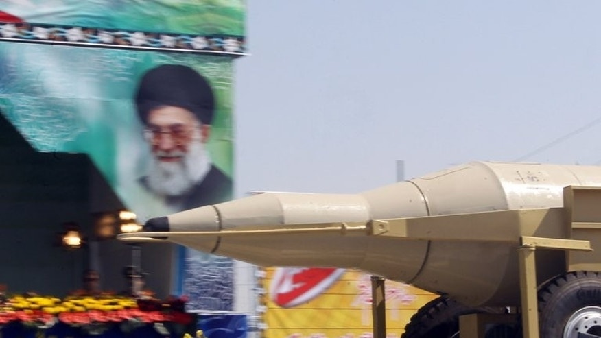A truck carries a Sejil missile past a large portrait of Iran's Supreme Leader Ayatollah Ali Khamenei during an annual military parade in Tehran, on September 22, 2013. Iran has paraded 30 missiles with a nominal range of 2,000 kilometres (1,250 miles), the first time it had displayed so many with the theoretical capacity to hit Israeli targets.