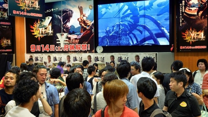Videogame fans queue up to buy 'Monster Hunter 4' in Tokyo on September 14, 2013.