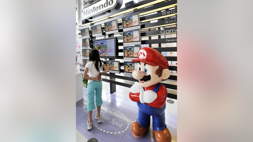 A mascot of Nintendo's popular game character Super-Mario standing at a showroom in Tokyo on July 30, 2008.