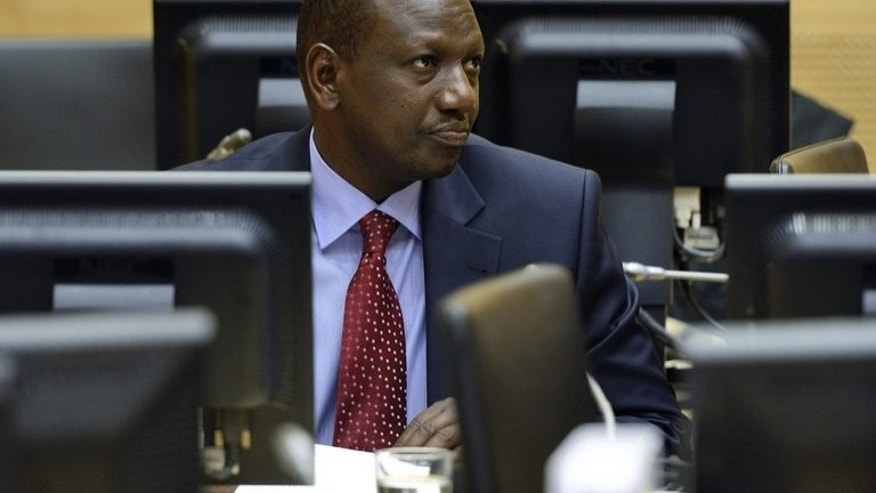Kenyan vice-President William Samoei Ruto looks on during a trial hearing in the International Criminal Court in the Hague, Netherlands, on May 14, 2013. Ruto asked the ICC on Sunday to adjourn his trial for crimes against humanity because of the deadly militant attack on a Nairobi shopping mall.