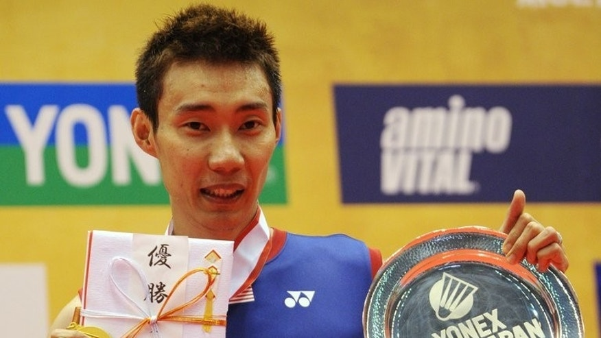 Top-seeded Lee Chong Wei of Malaysia shows off his gold medal at the Japan Open on September 22, 2013.