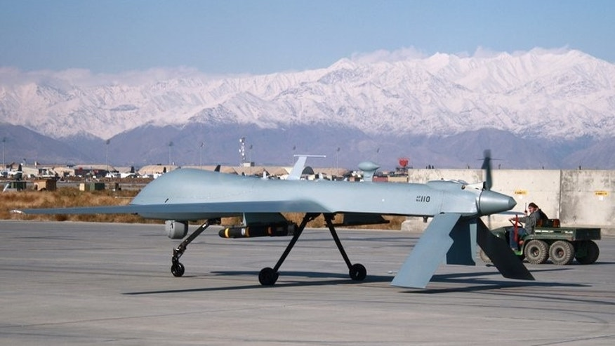 A US drone armed with a missile sets off from its hangar at Bagram Air Base in Afghanistan. At least six people were killed in a US drone strike on a militant compound in a northwestern Pakistani tribal area, security officials have told AFP.