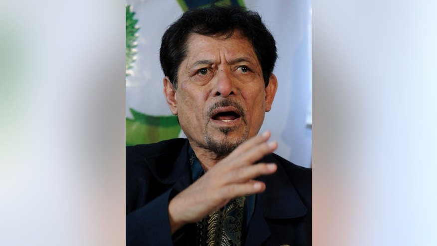 Moro National Liberation Front (MNLF) leader Nur Misuari talks to the media in Manila, on March 5, 2013. Philippines President Benigno Aquino has vowed to bring criminal charges against Misuari for a deadly attack on a major southern Philippine city that left hundreds dead or injured.