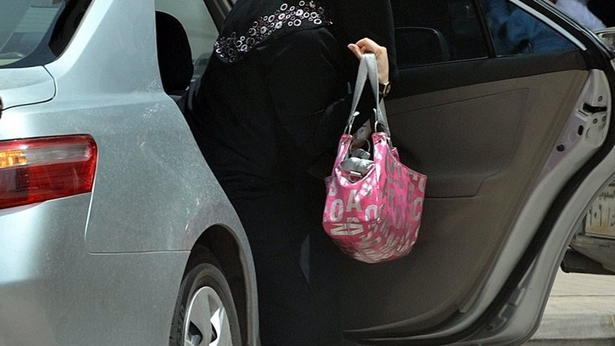 A Saudi woman gets out of a car after being given a ride by her driver in Riyadh, on May 26, 2011. Saudi women activists have called for a new day of defiance next month of the long-standing ban on women driving in the ultra-conservative kingdom.