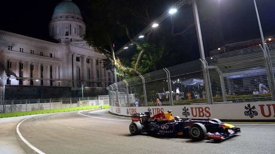 Red Bull driver Sebastian Vettel of Germany powers his car around the corner during the Formula One Singapore Grand Prix on September 22, 2013. Vettel went on to win the race.