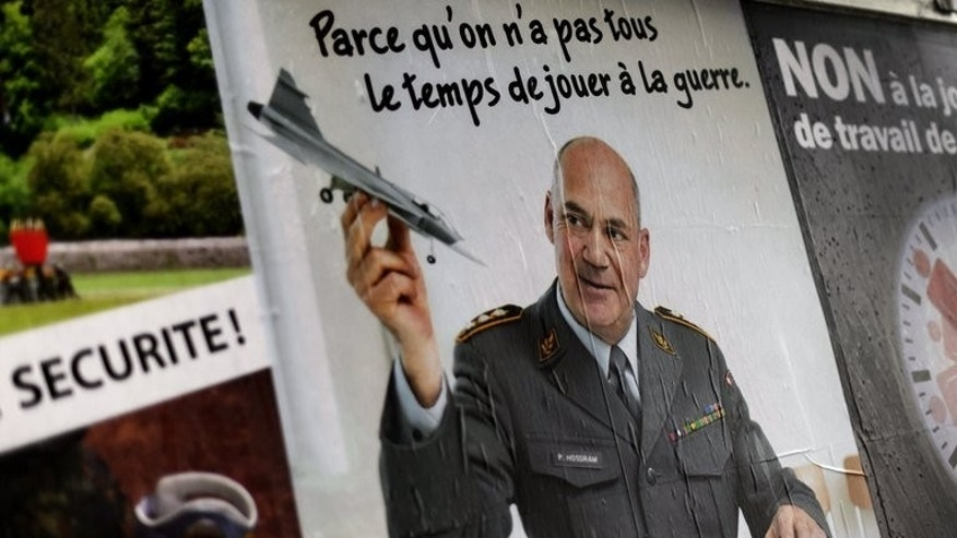 An electoral poster in favor of the abolition of the conscript army is displayed on September 16, 2013 in Geneva ahead of a referendum on axing the draft