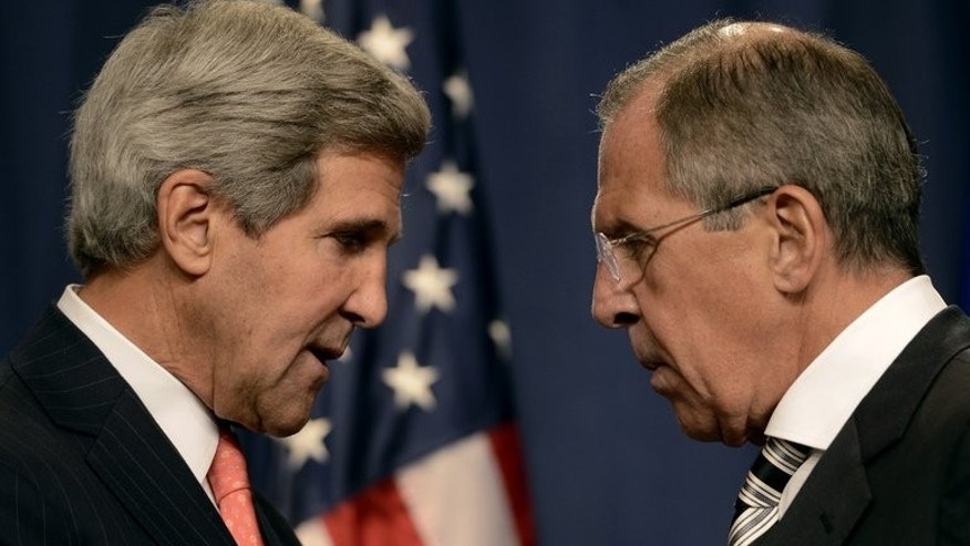 US Secretary of State John Kerry (lfet) speaks with Russian Foreign Minister Sergei Lavrov before a press conference in Geneva, on September 14, 2013. Lavrov has accused the United States of blackmailing Russia to support a tough UN resolution against Syria, and said the West is blinded by the idea of regime change in the war-torn country.