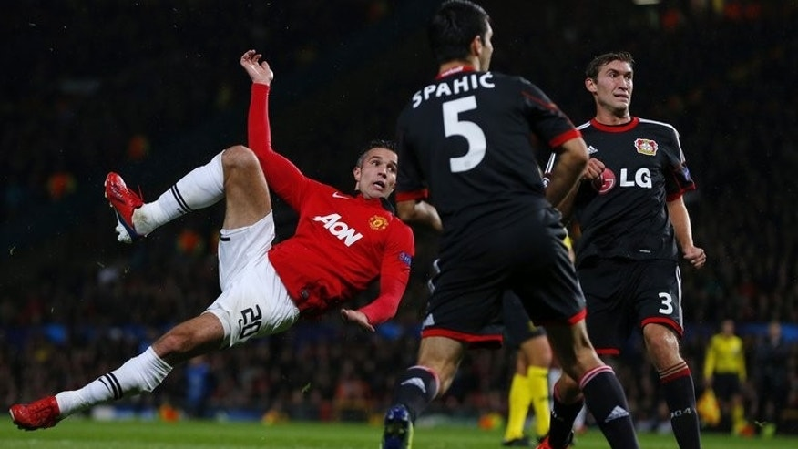Manchester United's Robin van Persie (left) scores during a UEFA match with Bayer Leverkusen, September 17, 2013. Van Persie was unexpectedly omitted from the Manchester United squad for their derby clash at Manchester City in the Premier League on Sunday.