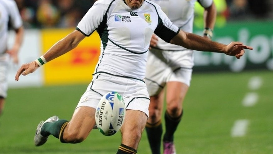 South African Springbok scrum-half Fourie du Preez kicks the ball during the 2011 Rugby World Cup match in Auckland on September 30, 2011.He is back in the South Africa squad for Rugby Championship home Tests against Australia and New Zealand.