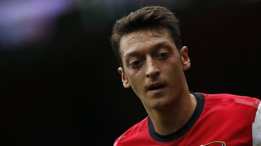 Arsenal's German midfielder Mesut Ozil plays at the Emirates stadium in north London on September 22, 2013.