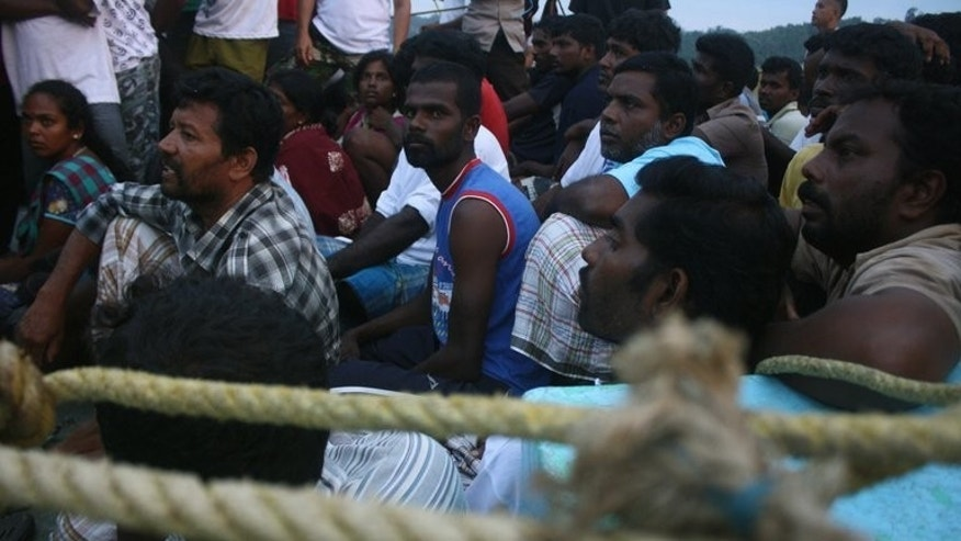 Asylum-seekers from Sri Lanka are pictured waiting on a boat at West Sumatra province on September 1, 2012. A retired Australian navy chief Tuesday criticised the government's decision to keep operations to repel vessels under wraps.
