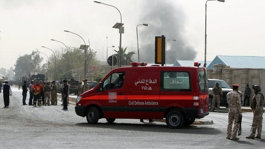 File picture shows an ambulance arriving at the scene of a bomb attack in Baghdad, on March 14, 2013. A bomb exploded near an ambulance taking a pregnant woman to hospital in Iraq on Monday, wounding her and killing two people, police and a doctor said.