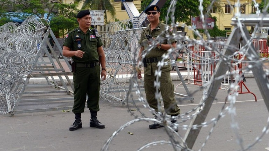 Cambodian police stand guard outside the National Assembly building in Phnom Penh on September 23, 2013.