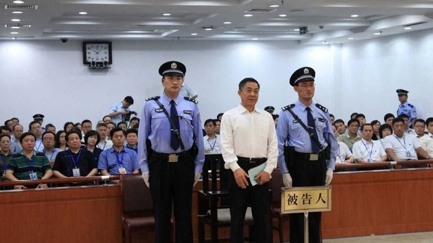 Former senior Chinese politician Bo Xilai stands in the Jinan Intermediate People's Court (IPC) as his corruption verdict is read out, on September 22, 2013. Bo has informed the court that convicted him to a life sentence over corruption that he will appeal, a source told AFP Monday, adding further drama to the high-profile case.