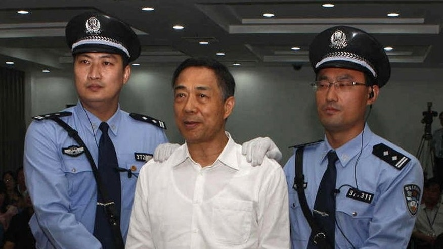 Former Chinese political star Bo Xilai in handcuffs at court in Jinan on September 22, 2013.