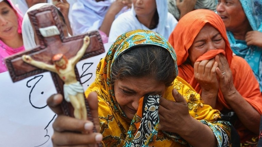Pakistani Christians protest against the suicide bombing in All Saints Church in Peshawar on September 23, 2013.