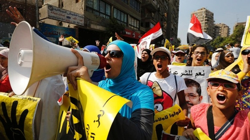 Sept. 6, 2013: Supporters of the Muslim Brotherhood chant slogans as they march in Cairo, Egypt.