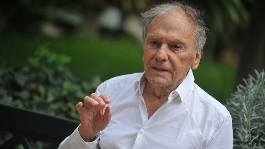 "French actor Jean-Louis Trintignant poses on October 9, 2012 in Rome during a promotion for ""Amour"" by Austrian film director Michael Haneke."