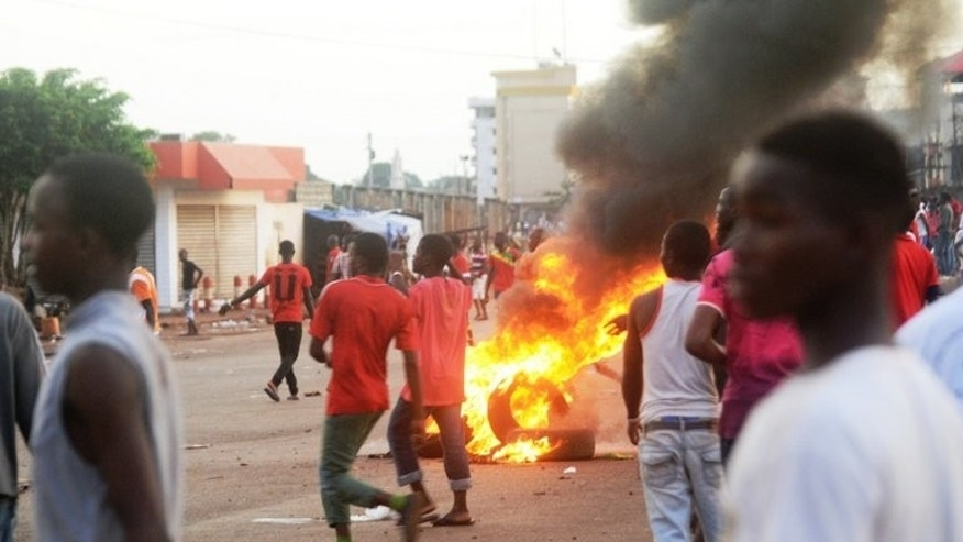 Guinean protesters confront the police in Conakry, on September 22, 2013. Opposition protesters have shot dead a trainee policeman and injured two other officers as renewed violence broke out in Conakry, five days ahead of elections.