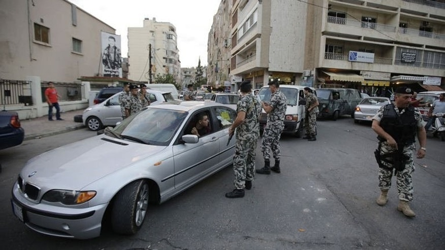 Lebanese security forces man a checkpoint in the southern suburb of the capital Beirut on September 23, 2013.