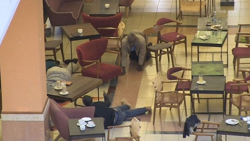 An image grab taken from footage shot by AFPTV's Nichole Sobecki shows shoppers taking cover inside the Westgate mall in Nairobi on September 21, 2013.