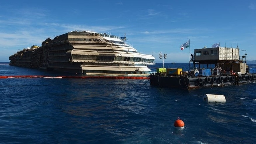 View from the Coast Guard ship on September 18, 2013, of the wreck of Italy's Costa Concordia cruise ship after emerging from water, near the harbour of Giglio Porto.