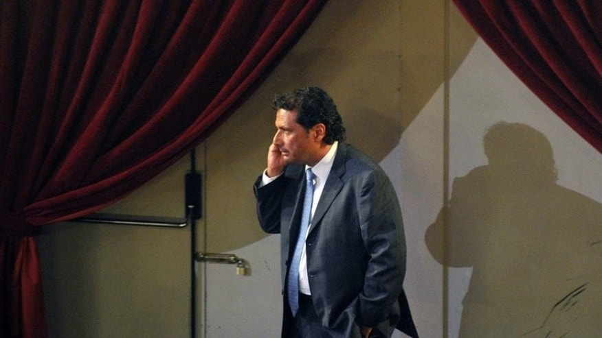 Costa Concordia's captain Francesco Schettino speaks on his mobile phone during a break of his trial on July 17, 2013 in a local theatre in Grosseto.