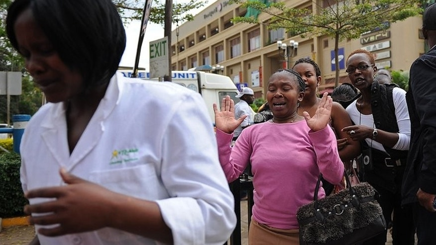 A woman who had been held hostage flees the Westgate shopping mall in Nairobi, on September 21 2013. For many families, the anguished search for loved ones missing since the start of the Kenyan mall siege ends at the Nairobi City Mortuary.