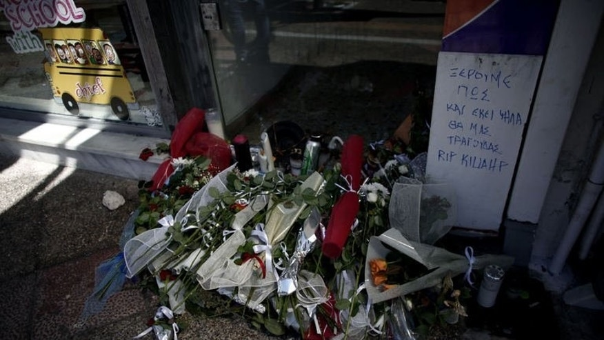 Flowers are seen on September 19, 2103 at the spot where Pavlos Fyssas was murdered, in Piraeus, Greece.