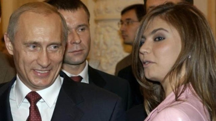 Putin and Kabayeva, pictured in 2004. (AP Photo)