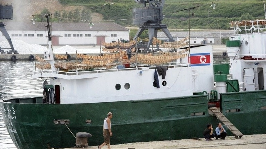 North Korean fisherman unload at the port city of Rajin, where a railway to Russia begins, on September 2, 2011.