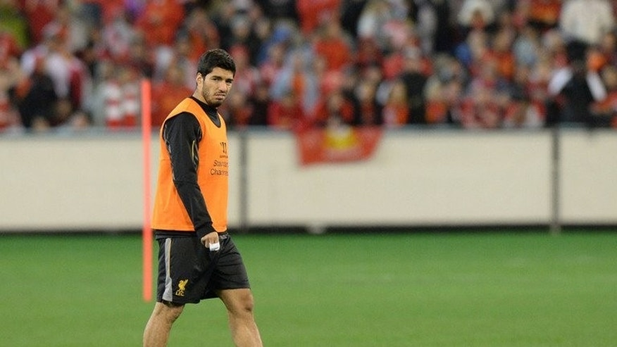 Liverpool forward Luis Suarez attends a football training session in Melbourne on July 23, 2013.