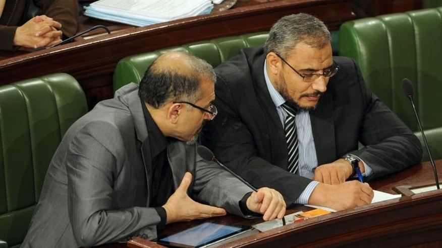 Tunisia's Islamist Prime Minister Ali Larayedh (L) chats with the leader of Ennahda's Parliamentary group, Sahbi Atig at a constituent assembly meeting on September 19, 2013.