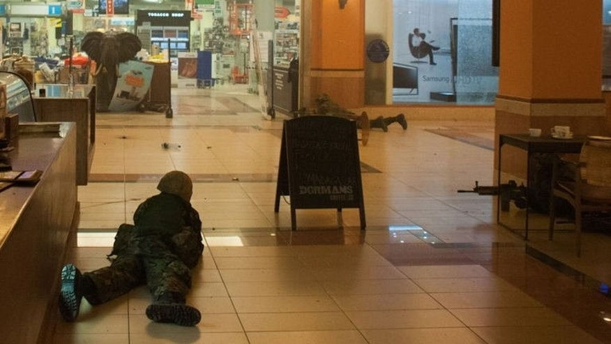 Kenyan troops take position on September 21, 2013 inside the Westgate mall in Nairobi.