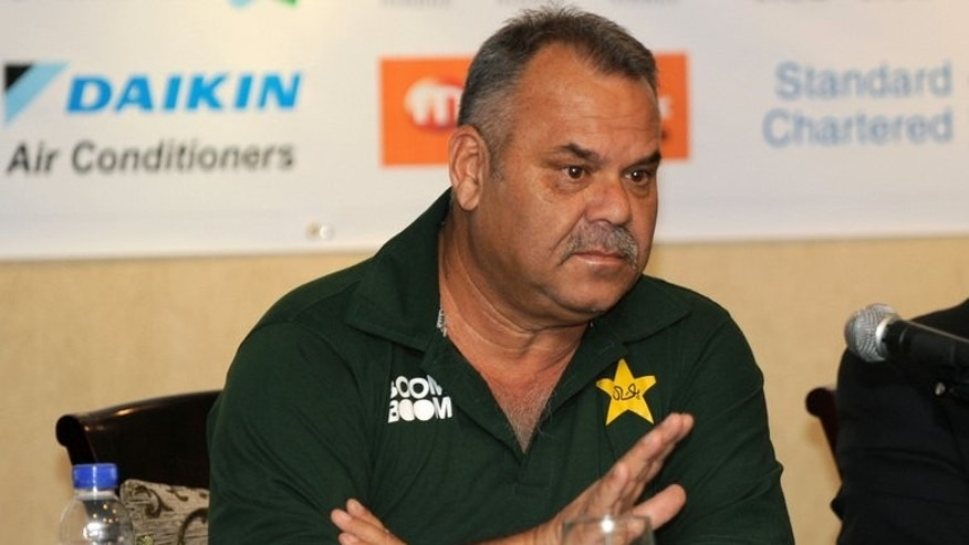 """Pakistan coach Dav Whatmore speaks during a press conference in Dhaka on March 8, 2012. Whatmore admitted he was """"embarrassed"""" by his side's Test defeat to minnows Zimbabwe but insisted they could bounce back against South Africa."""