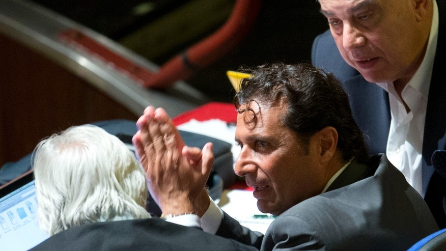 Sept. 23, 2013 - Capt Francesco Schettino, right, talks to his lawyer Domenico Pepe during a pause of his trial in an Italian court room in Grosseto, Italy. The captain of the wrecked Costa Concordia blamed his helmsman Monday for botching a last-minute corrective maneuver that he contends could have prevented the massive cruise ship's collision with a reef off an Italian island.
