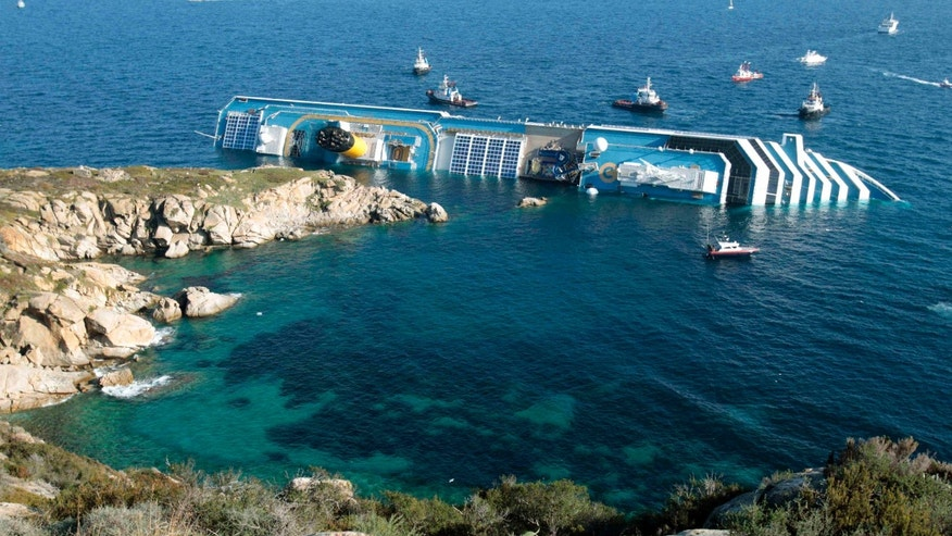 Jan. 14, 2012 - FILE photo of the luxury cruise ship Costa Concordia leaning on its side after running aground in the tiny Tuscan island of Giglio, Italy.