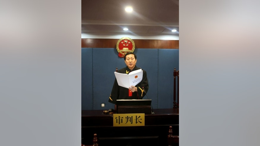 This picture taken on September 22, 2013 and released by Jinan Intermediate People's Court shows presiding judge Wang Xuguang announcing the verdict for fallen Chinese political star Bo Xilai (out of frame) in a courtroom in Jinan, east China's Shandong province.