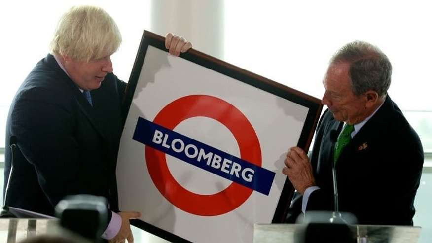 London Mayor Boris Johnson (L) presents a personalised London Underground plaque to New York Mayor Michael Bloomberg at City Hall during the launch of the Mayors Challenge in London on September 24, 2013.