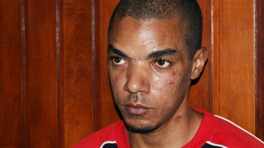 Briton Jermaine Grant sits in court in Kenya's coastal town of Mombasa on May 9, 2012. A British detective gave evidence Tuesday in Kenya at the trial of Grant, accused of ties to Somalia's Al-Qaeda-linked Shebab and plotting attacks.