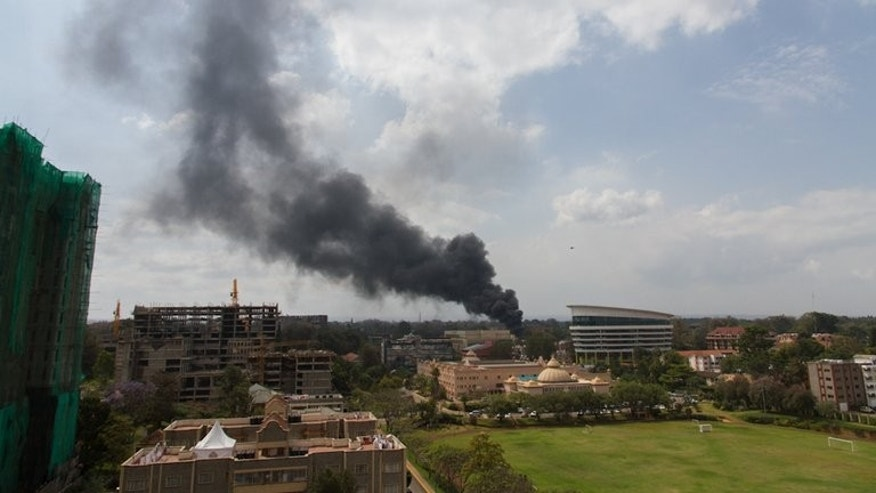 "Smoke rises on September 23, 2013 from the beseiged Westgate shopping mall in Nairobi following an explosion. As Kenyan special forces closed in on holdout Islamist fighters battling in a Nairobi mall Tuesday, speculation grew that a British woman nicknamed ""the white widow"" was among the attackers."