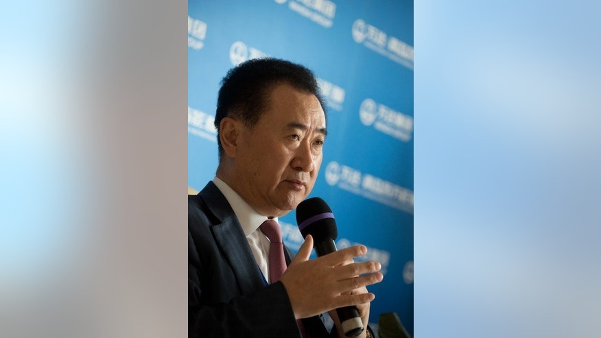 China's richest person Wang Jianlin speaks during a press conference for the ambitious Oriental Movie Metropolis in the eastern port city of Qingdao on September 22, 2013.