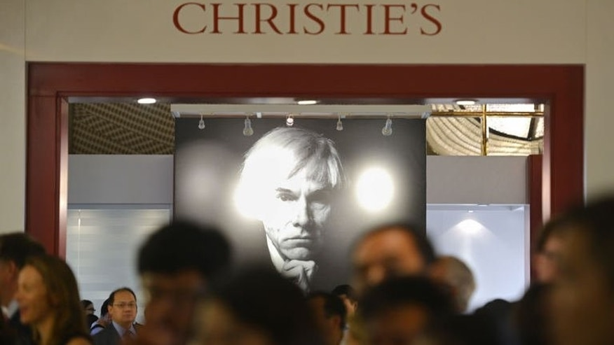 A photograph of US artist Andy Warhol is displayed at a preview of a Christie's auction in Shanghai on September 24, 2013.