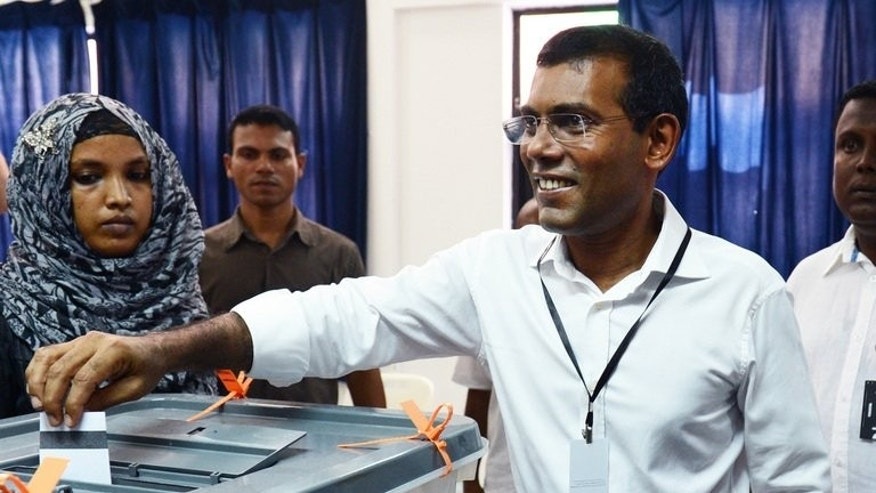 Maldivian presidential candidate Mohamed Nasheed smiles as he casts his vote at a local polling station in Male on September 7, 2013.