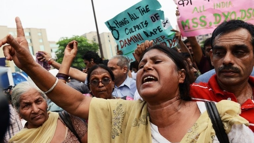 An Indian woman shouts slogans calling for the death penalty for four men convicted of rape and murder outside the Saket courthouse in New Delhi on September 13, 2013. Four men condemned to death for the murder and gang-rape of an Indian student have been brought back to court as their lawyers confirmed before judges that they would appeal the sentences.